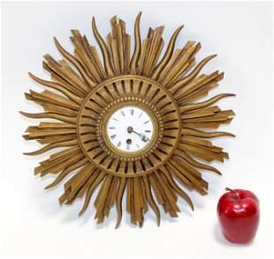 French gilt wood sunburst clock