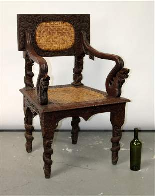 Indonesian relief carved armchair with rattan seat