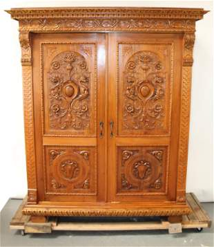 Italian Renaissance carved walnut armoire with cabochon