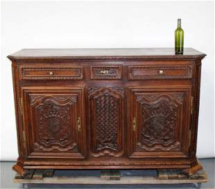 French 19th c carved oak buffet bas with crests