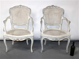 Pair of French Louis XV style caned armchairs