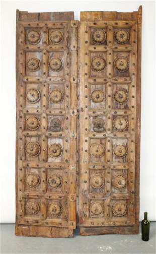 Heavily carved and studded double doors