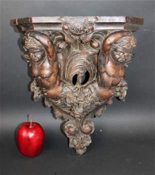 Italian relief carved corbel with cherubs