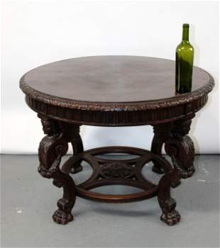 French round foyer table with carved caryatids