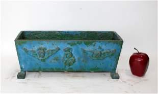 Antique French cast iron garden planter with cherubs