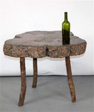 Live edge burled slab cocktail table on legs