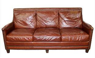 Leather sofa with studded nail head trim