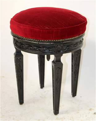 French carved and ebonized piano stool