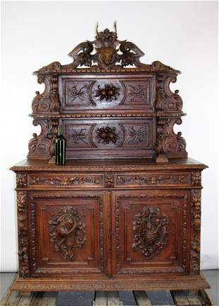 French Buffet St. Hubert in oak with carved deer head