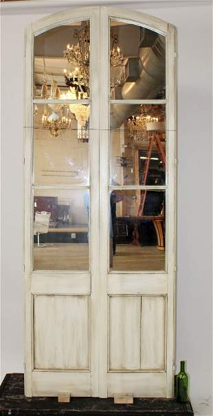 Pair of French painted arch top mirrored door panels