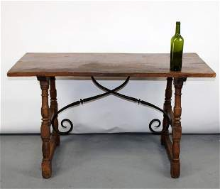 Italian trestle table in walnut with iron stretcher