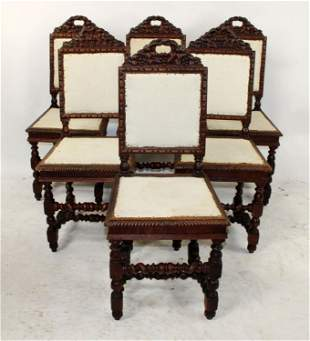Set of 6 French Louis XIII carved oak chairs