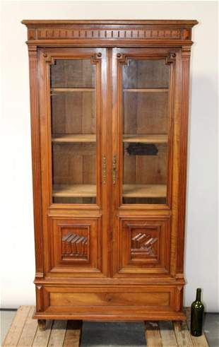 French walnut 2 door bookcase with relief carved books