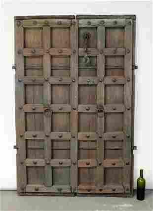 Pair of raised panel rustic doors