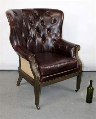 Curved back tufted leather club chair
