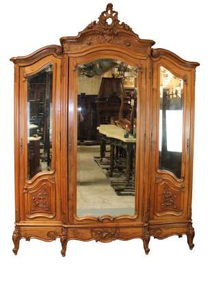 Louis XV style triple armoire in walnut