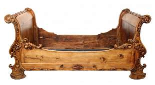 Antique French carved walnut sleigh day bed