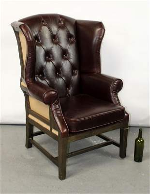 Tufted leather wing back armchair
