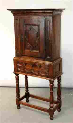 French 18th century oak cabinet on legs