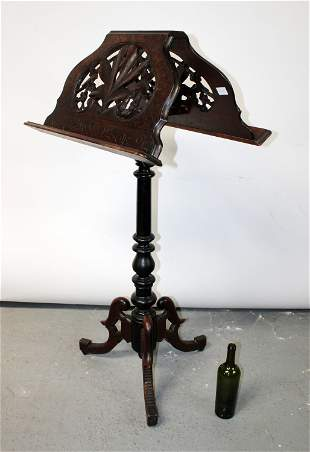 French Black Forest double sided book rest on pedestal