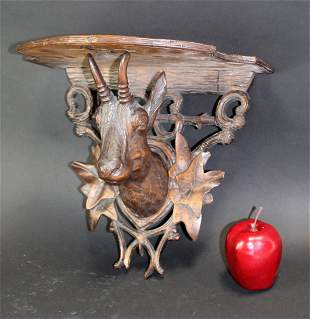 Black Forest etagere wall shelf with antelope head