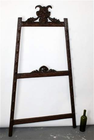 French Black Forest carved pool cue rack with Bacchus