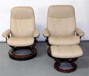 Pair Ekornes Norway tan leather lounge chairs