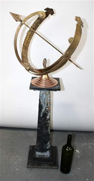 Polished bronze armillary sundial on iron base