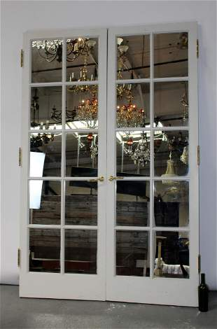 Pair of painted wood doors with paned mirrors