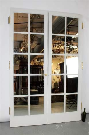 Pair of painted wood paned mirror doors