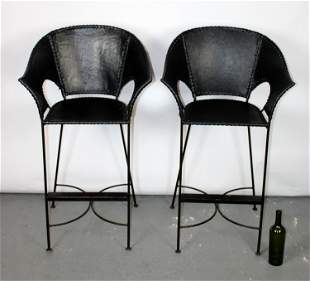 Pair of bull hide leather bar stools