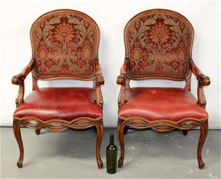 Pair of mahogany and red leather armchairs
