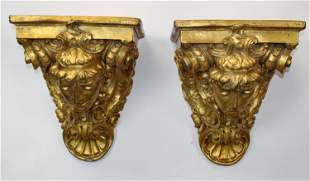 Pair of cast and painted figural corbels