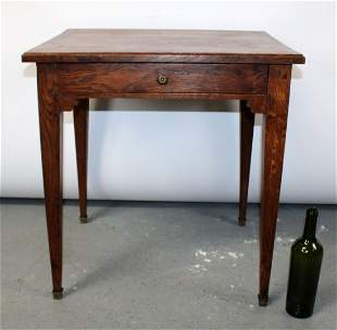 French Louis XVI style table in oak with tapered legs