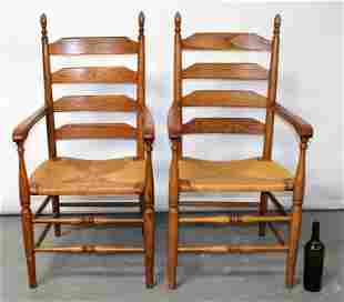 Pair of oak ladder back armchairs with rush seats