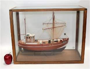 Wooden ship model in case