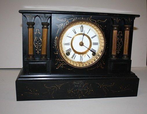14: Black iron Ansonia mantel clock with key