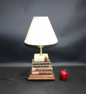 Stacked leather bound books desk lamp