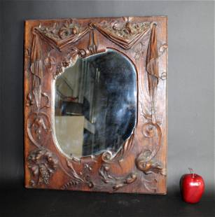 Antique French carved oak mirror