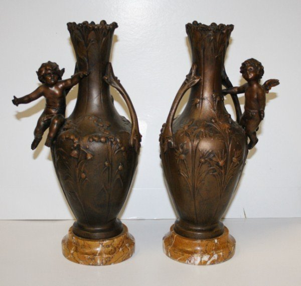 5: Pair of urns with cherubs on marble bases