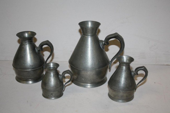 11: Lot of 4 small pewter pitchers