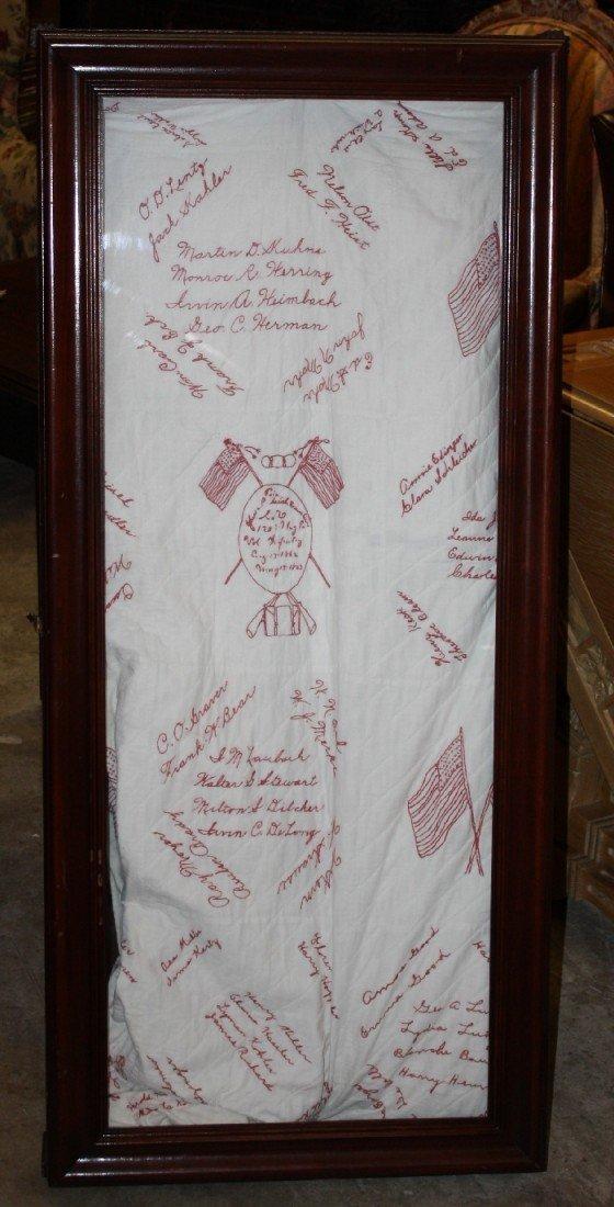 24: Hand stitched quilt in shadowbox