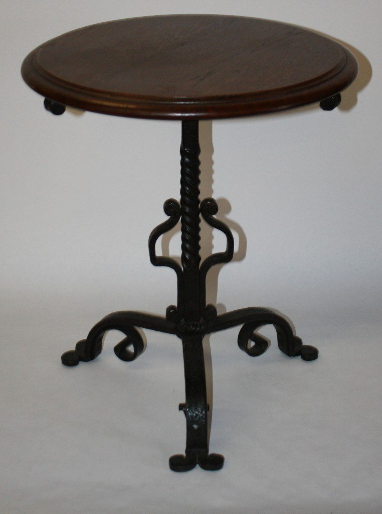 14: French round table with scrolled iron base