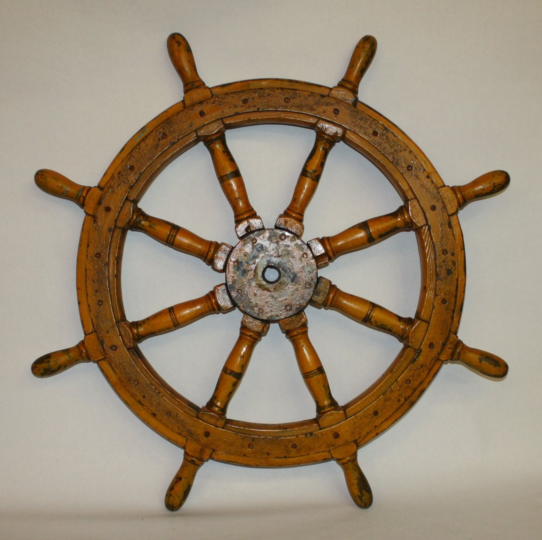 1: Painted wooden ships wheel