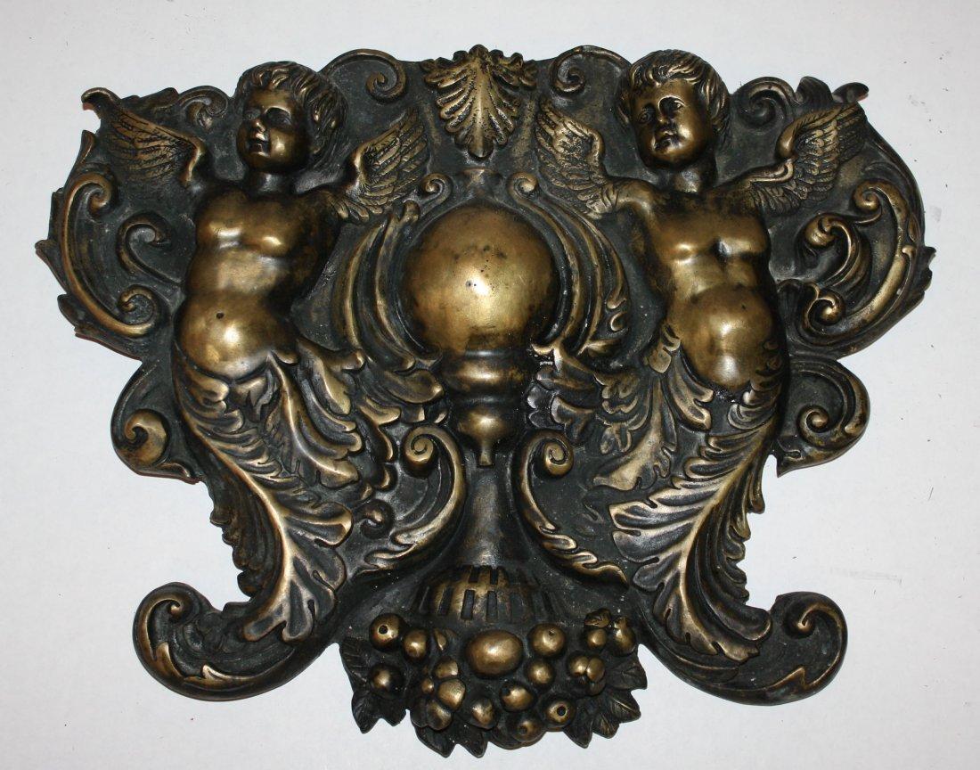 11: Bronze relief plaque with cherubs
