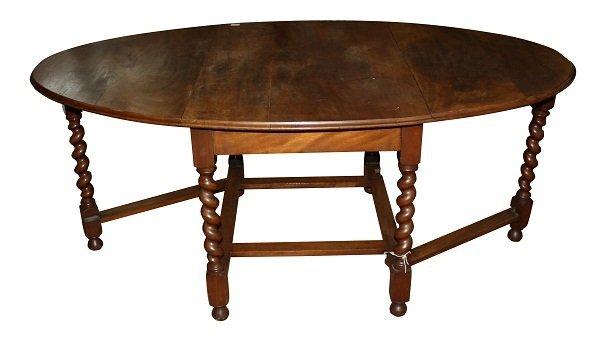 12: Mahogany oval drop side pub table with barley twist