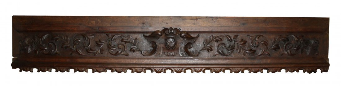 14: French carved wood valence with cabochon crest