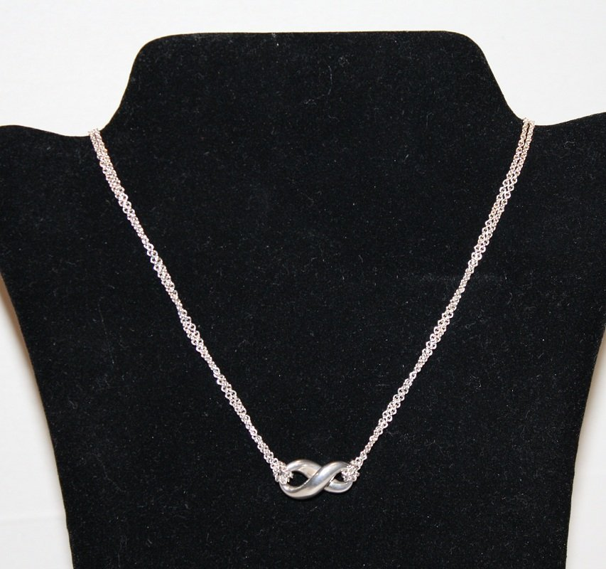 164: Tiffany & Co. sterling silver infinity necklace on