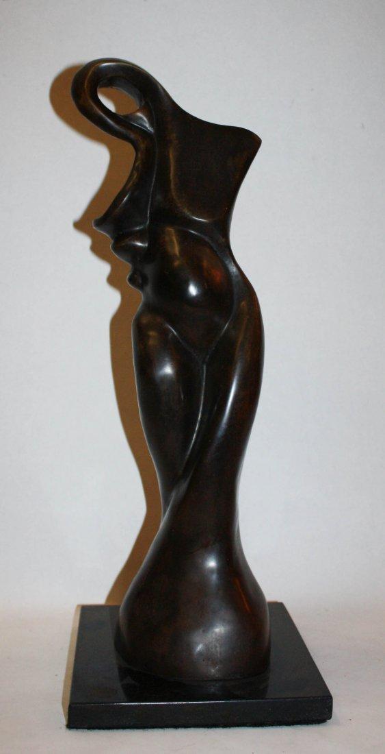 16: Abstract female sculpture in bronze signed Garrauza