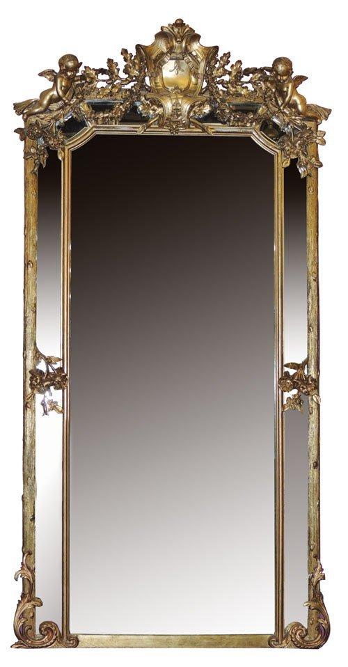 71: Italian 19th century gilt beveled mirror w/ cherubs